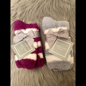 two pastel gray and purple super soft socks